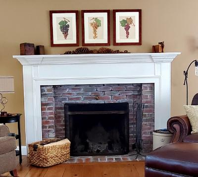 a decorative way of displaying a set of 3 framed antique wine prints, lithographs over 100 years old, of wine grapes.