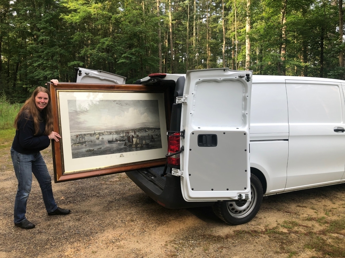 Anne Hall of Anne Hall Antique Prints, is loading her van, so people can shop her amazing antique lithographs and hand-colored engravings at antiques shows and other events. Comically this huge historic piece barely fits!